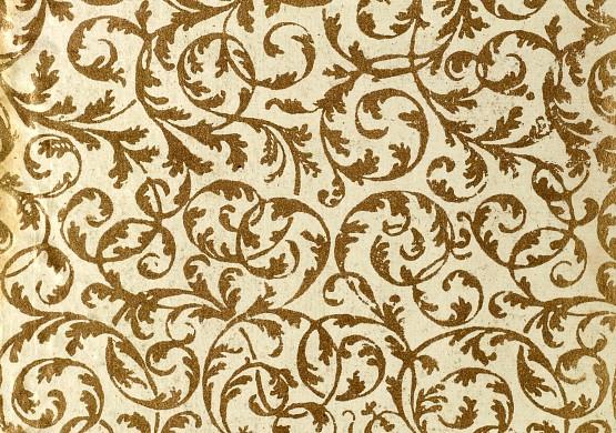 Papier dominoté. Rinceaux dorés sur fond blanc